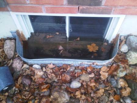 Water comes from bottom of window well