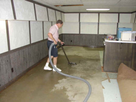 vacuuming water from the ground flooded basement